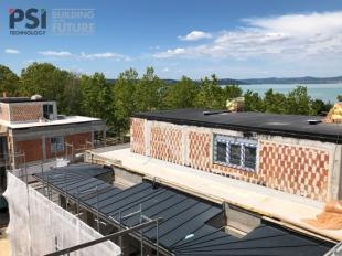 A tetőről gyönyörködünk a kilátásban, Scamard 1082 társasház kivitelezés